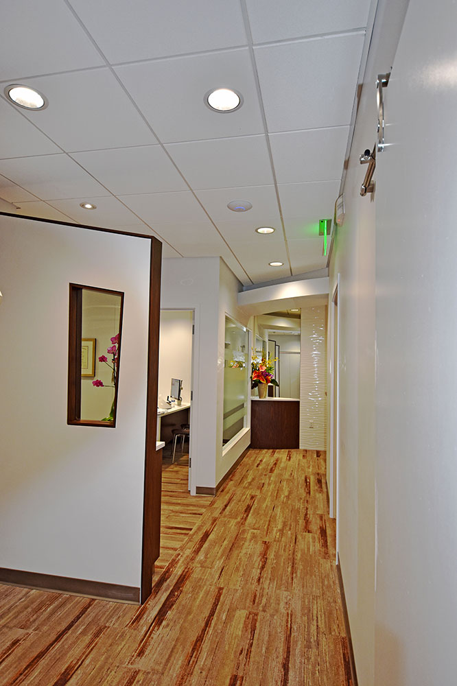 Hallway with custom wall and pano window at Issaquah Premier Dental