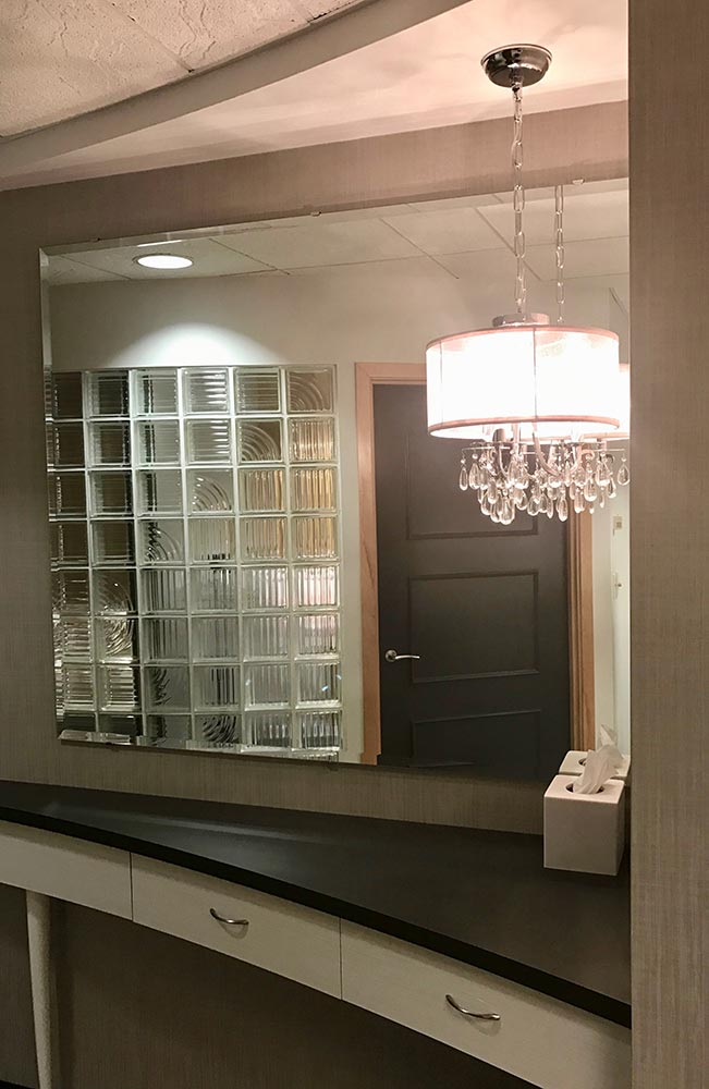 custom curved cabinetry and chandelier add a modern touch of class to an Endodontic office tenant improvement